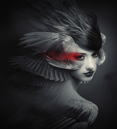 Фото Девушка с крыльями у лица и красным дымом в уголках глаз