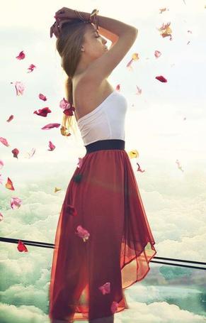 Фото Девушка в красной юбке с поднятыми руками стоит на фоне облаков и падающих лепестков (© ), добавлено: 06.04.2013 20:18
