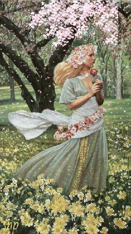 Фото Персефона в весеннем саду с цветком в руках