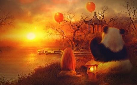 Фото Девочка и панда с красными воздушными шариками сидят на берегу и смотрят на закат, рядом фонарь