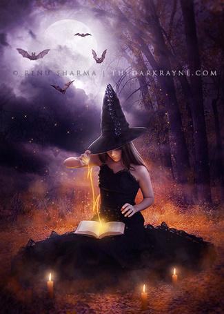 Фото Ведьма в черном платье и колпаке с магической книгой, сидит в лесу, рядом с ней свечи и летают летучие мыши, арт TheDarkRayne
