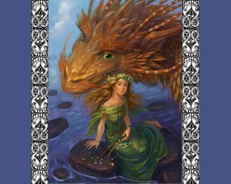 Фото Девушка сидит на камнях в море, к ней нежно прижимает голову огромный дракон