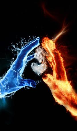 Фото Между руками, одна их которых символизирует воду, другая огонь, находится сердце из дыма