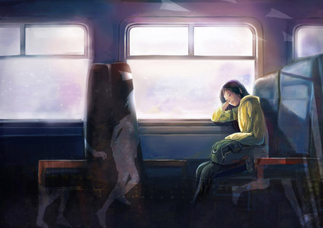 Фото Грустная девушка с сумкой сидит в поезде