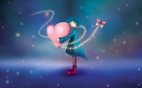 Фото Девочка держит в руках розовое сердечко