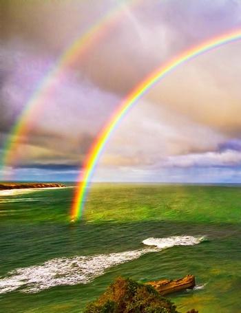 Фото Двойная радуга над морем