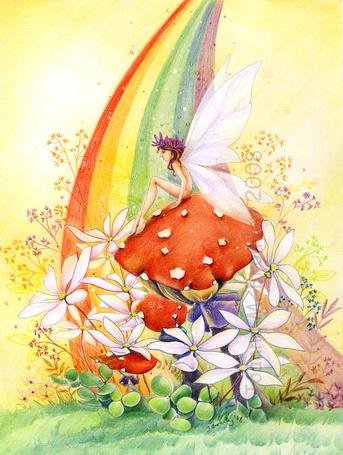 Фото Фея сидит на мухоморе, окруженном цветами, под радугой