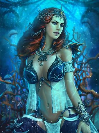 Фото Девушка эльфийка под водой с рыбками на заднем фоне кораллы