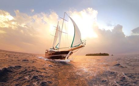 Фото Яхта в море на фоне неба и виднеющегося островка в дали