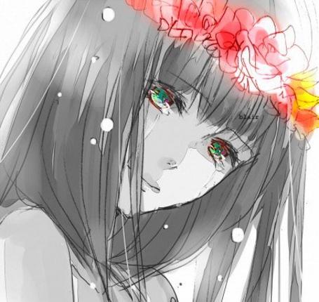 Фото Плачущая девушка с цветочным венком на голове