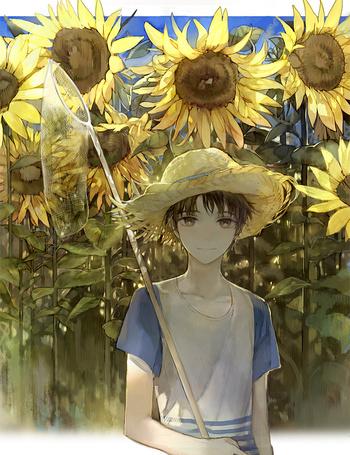 Фото Парень в шляпе и с сачком в руке возле подсолнухов