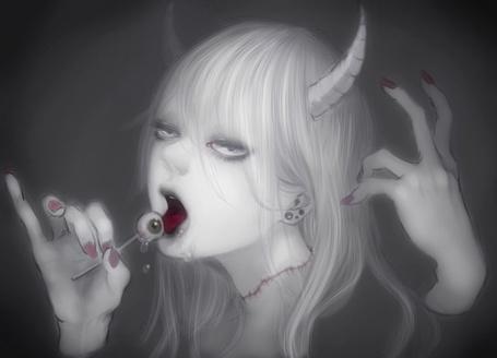 Фото Девушка демон ест чупа-чупс в форме глаза