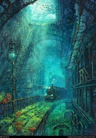 Фото Паровоз катится по железной дороге под водой, пуская пар, вокруг городские пристройки