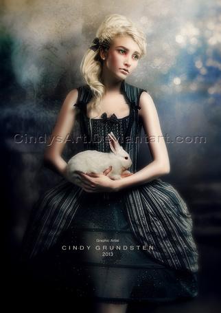 Фото Грустная девушка в черном платье с кроликом на руках, автор Cindy Grundsten