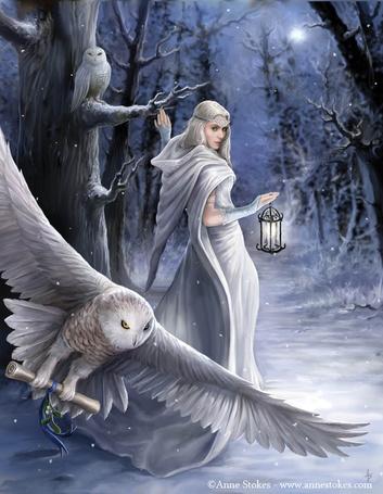 Фото В зимнем ночном лесу, при свете луны, девушка стоит возле дерева, держась за сук, рядом две совы одна взлетает держа какое то послание в лапах