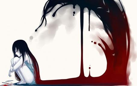 Фото Плачущая девушка с порезанной рукой сидит на полу, а из ее волос показывается монстр