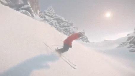 Фото Человек в горах катается на лыжах