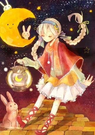 Фото Девушка с фонорем в руке разговаривает с плачущим кроликом
