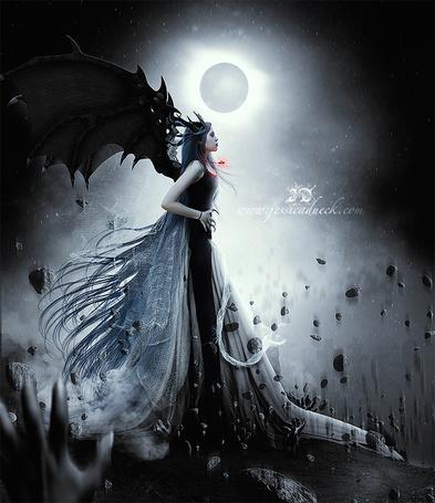 Фото Девушка - демон стоит на фоне, с земли взлетают камни, фото-арт jessicadueck