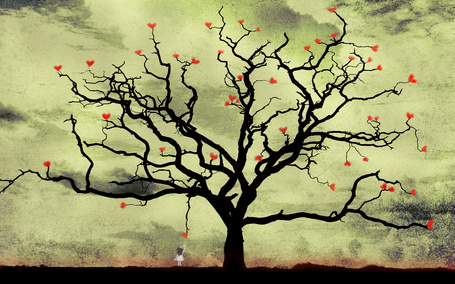Фото Девочка пытается дотянуться до ветки дерева, на которой висит красный листок в виде сердечка