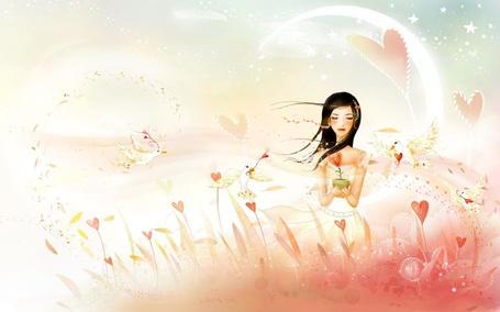 Фото Девушка с цветком в форме сердца в руках идет по полю среди таких же цветов