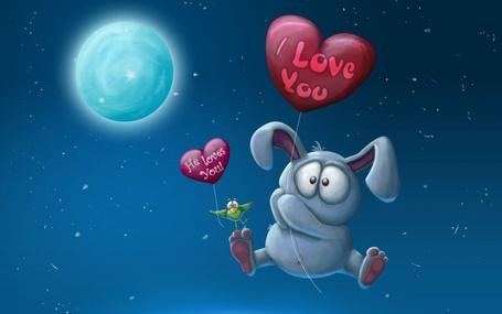 Фото По небу на фоне луны летит кролик на шарике с надписью I love you / Я люблю тебя, на ноге которого сидит птичка с шариком He loves you / Он любит Вас