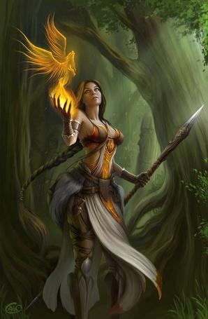 Фото Девушка держит копье в одной руке, а из другой выпускает огненного волка с крыльями на фоне леса