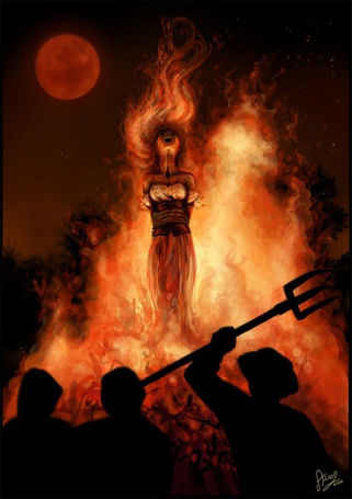 Фото Девушка, привязанная к столбу, горит в огне и кричит от боли, рядом стоят люди с вилами