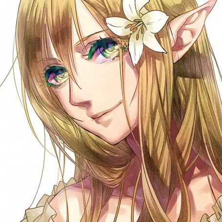 Фото Девушка-эльф с лилией в волосах