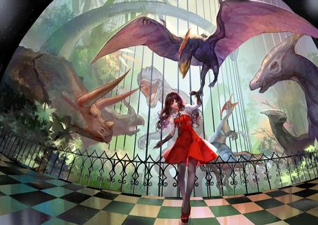 Фото Девушка в красном платье среди динозавров