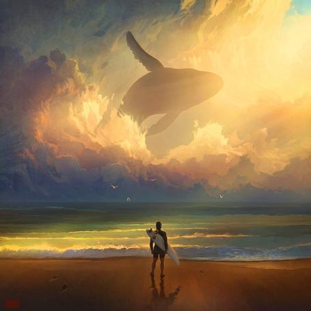 Фото Мужчина держит в руках доску для серфинга, стоя на берегу моря и смотря на летающего в облаках кита, художник RHADS