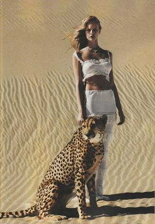 Фото Девушка стоит рядом с леопардом, фотограф Will Davidson