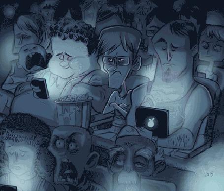 Фото Люди сидят в кинотеатре и смотрят в телефоны