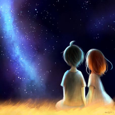 Фото Мальчик с девочкой сидят на высокой траве и смотрят на звездное небо