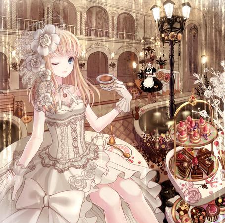 Фото Девушка сидит на столе и пьет чай