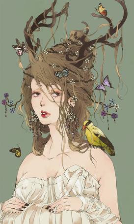 Фото Девушка с рогами, на которых сидят бабочки