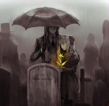 Фото Девушка и парень стоят около нагробья