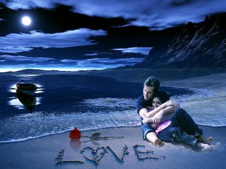 Фото На берегу реки мужчина и женщина, рядом на песке лежит роза и надпись LOVE (Любовь)
