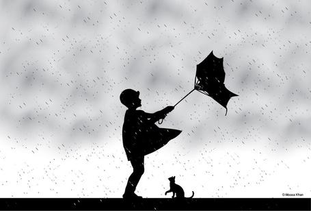 Фото Мальчик с зонтом и рядом котенок под дождем