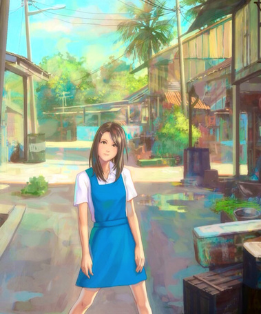 Фото Девушка в голубом платье стоит на дороге между домами