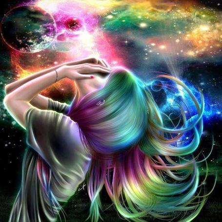 Фото Девушка, закрывшая лицо руками, стоит на фоне космоса