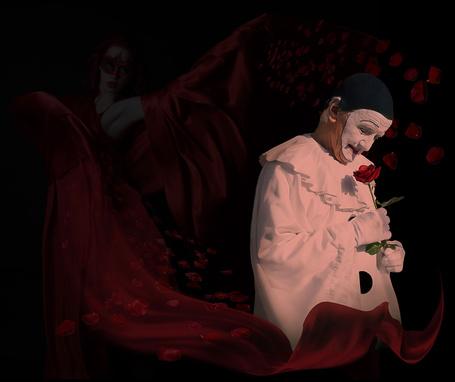 Фото Грустный клоун, держащий в руке алую розу, позади него стоит девушка-танцовщица в пышном, красном платье, автор Nataliorion