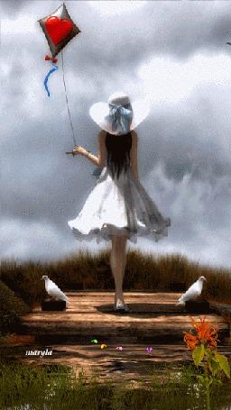 Фото Девочка с воздушным змеем стоит на мосту, по обе стороны которого сидят голуби