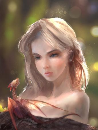 Фото Девушка смотрит на дракончика