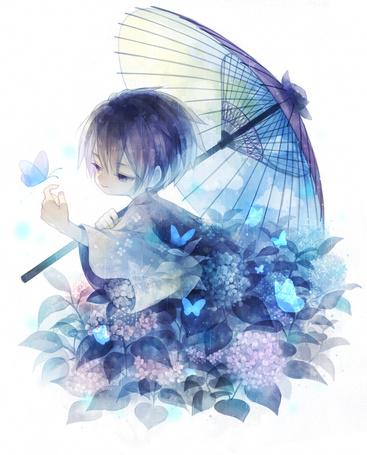 Фото К мальчику на руку садится бабочка
