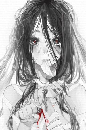 Фото Плачущая девушка режет себе запястье