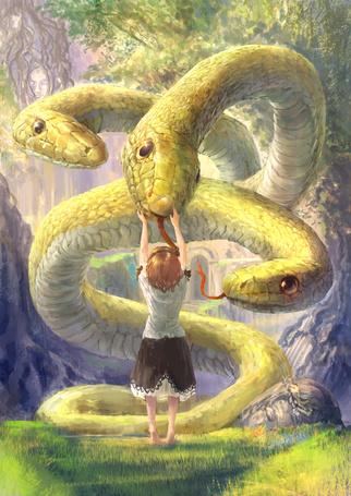 Фото Девочка гладит трехглавую змею