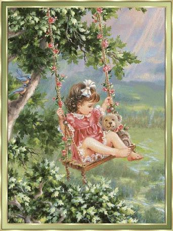 Фото Маленькая девочка катается на качелях