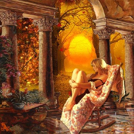 Фото Девушка сидит, качаясь в кресле-качалке осенним днем, с деревьев опадают листья