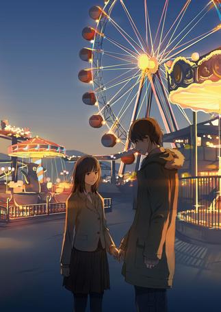 Фото Парень и девушка в лунапарке
